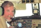 Pilot Max Quartermain at the controls of his Beechcraft aircraft.