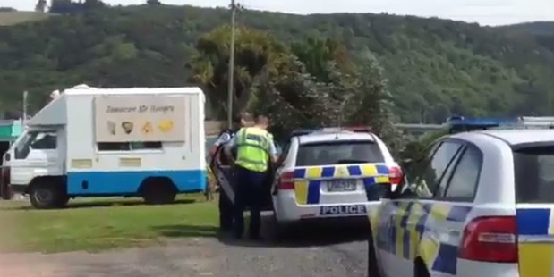 Loading A man is arrested at Taieri River, near Dunedin, after another man was injured with a machete. Photo / Otago Daily Times