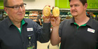 Store manager Richard Croucher (left) and produce manager James O'Connor hold contrasting potatoes. PHOTO/ BEVAN CONLEY