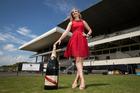 Champagne Mumm's Mathilde Laborde with the bottle. Photo / Jason Oxenham