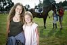 Une Erasmus 14 (left) and Katelyn Stenzel 10, enjoyed checking out the action at the North Island Show Jumping Championships at Tauranga Racecourse. Photo/Andrew Warner