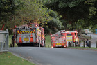 Fire crews at Long Bay College after its art and technology block was destroyed in an accidental fire overnight. Photo / Michael Craig