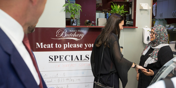 Jacinda Ardern  in Khan's Halal Butchery chatting with shopper Dalal Omar about tomorrow's  byelection. Photo / Nick Reed