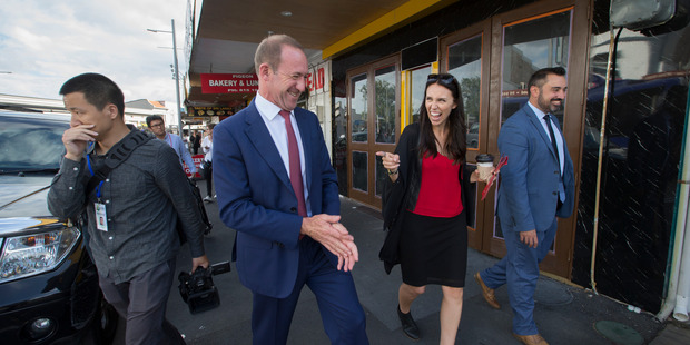 Labour party leader, Andrew Little walks with MP Jacinda Ardern along Sandringham road chatting with local business' about Mount Albert By-Election. Photo / Nick Reed