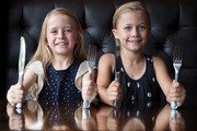 Pippa Lynch-Blosse, 8, (left) and friend Natalia Gilchrist, 8, show off their table manners in Portofino restaurant, Takapuna. Photo / Nick Reed