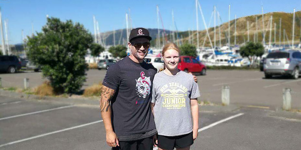 Loading Caitlin O'Reilly pictured with her coach John Garfield. Picture / Coast Swim Club