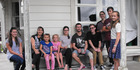 The Arthur family from left: Shantae, Marie, Brontie, Kayla, Hayley Smith, (Nick's fiancée) Nick, Caleb, Brianna, Josiah and Sophia. Missing is dad Blair and eldest daughter Caitlin. PHOTO/LIN FERGUSON