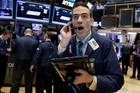 A rally in shares of DuPont lifted the Dow to a fresh record high. Photo / AP