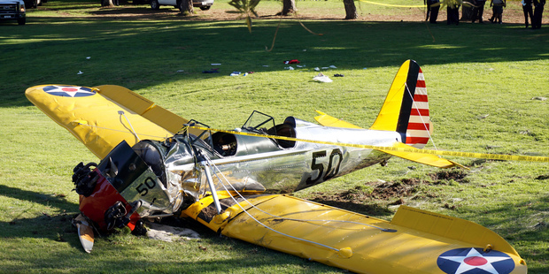 In this March 5, 2015 file photo, a World War II-era trainer airplane rests on the ground after actor Harrison Ford crash-landed it after reporting engine failure. photo / AP