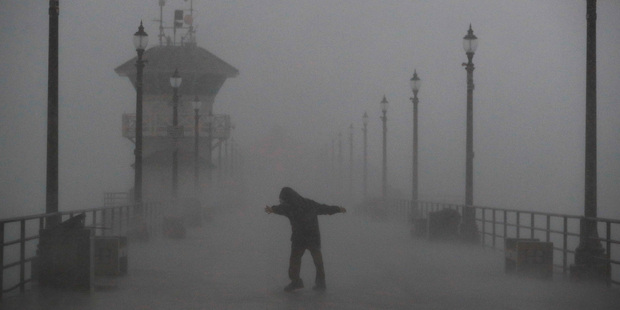 Winds of up to 115km/h lash the pier at Huntington Beach. Photo / AP