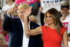 President Donald Trump points to his wife, first lady Melania Trump during a campaign rally. Photo / AP