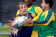 Dan Vickerman, left, and Anthony Fainga'a, right, compete for the ball during a team training session in Auckland in 2011. Photo / AP