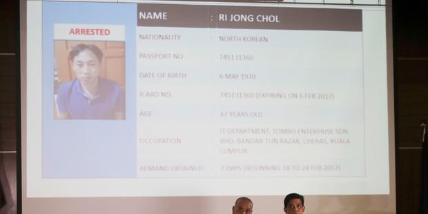 Malaysia Deputy Inspector-General of Police Noor Rashid Ibrahim, left, speaks about detained North Korean Ri Jong Chol. Photo / AP