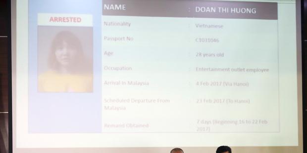 Malaysia Deputy Inspector-General of Police Noor Rashid Ibrahim, left, speaks about detained Vietnamese Doan Thi Huon. Photo / AP