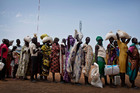 Women who fled fighting in nearby Leer in recent months, queue for food aid at a food distribution made by the World Food Programme in Bentiu, South Sudan. Photo / AP