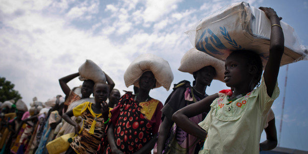 In this photo taken October 19, 2016 and released by UNICEF, a young girl queues for food aid at a food distribution made by the World Food Programme in Bentiu, South Sudan. Photo / AP