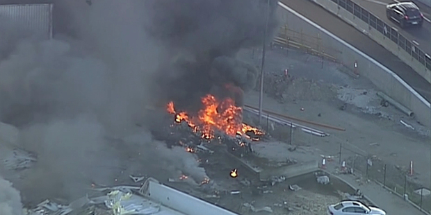 The light plane had just taken off from Essendon airport when it crashed into the factory shop outlet. Photo / 9News