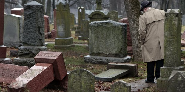 Vandals damaged or tipped over dozens of headstones at Chesed Shel Emeth Cemetery in University City,  Missouri. Photo / AP