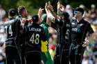 Tim Southee is congratulated by teammates after dismissing South Africa's Hashim Amla. Photo / AP