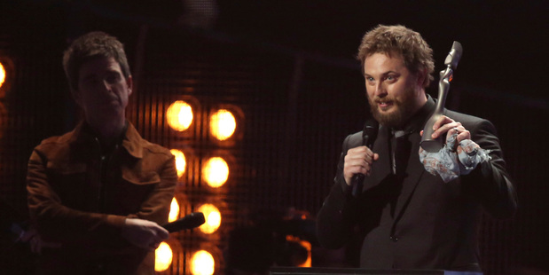 Duncan Jones, right, son of the late David Bowie, accepts the award for Album Of The Year on behalf of his father. Photo/AP