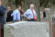 Missouri Governor Eric Greitens and US Vice President Mike Pence view some of the damage done at the Chesed Shel Emeth Cemetery yesterday. Photo / AP