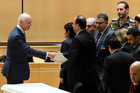 UN Special Envoy of the Secretary-General for Syria Staffan de Mistura, left, shakes hands with Syria's main opposition High Negotiations Committee (HNC) leader Nasr al-Hariri, center. Photo / AP