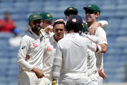 Australia's Steve O'Keefe, center, celebrates the dismissal of India's Ajinkya Rahane. Photo / AP