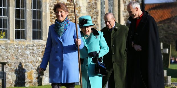 Britain's Queen Elizabeth II and her husband Duke of Edinburgh, centre, arrive at St Peter and St Paul at West Newton. Photo / AP
