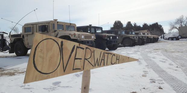 Military vehicles staged near the path of the Dakota Access pipeline on February 9, 2017 near Cannon Ball, North Dakota. Photo / AP