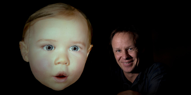 Dr Mark Sagar with Baby X, a digital baby created through watching his own daughter. Photo / Brett Phibbs
