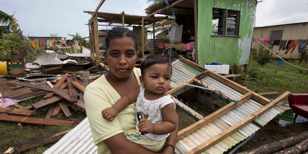 Shahista Bano with her then 8-month-old son, Ikram, just after Cyclone Winston. Photo /  Brett Phibbs