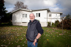 Rusty Kane at the council-owned house that has sat empty for about 18 months behind Brookfield retirement village. Photo/file