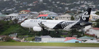 An Air New Zealand Airbus A320 landing at Wellington Airport. Picture / Mark Mitchell.