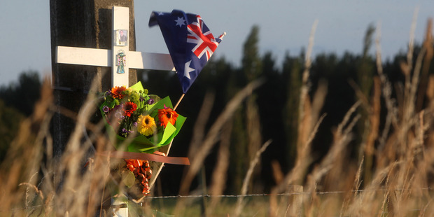 MEMORIAL: An Australian flag on the memorial cross at the site of the crash that killed two Australians on a school trip in 2014. PHOTO/FILE