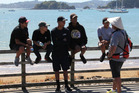 A police iwi liaison officer chats with young men at the Waitangi waterfront. Engaging with people, not law enforcement, is the key to being an ILO, policeman Pat Davis says. PHOTO/PETER DE GRAAF