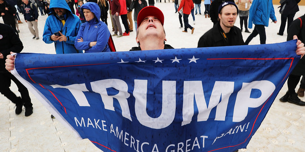 A US President Donald Trump supporter reacts on the National Mall to the inauguration of US President Donald Trump. Photo / Getty Images