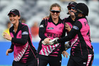 Anna Peterson of New Zealand is congratulated by team mates after getting a hat-trick. Photo / Getty Images