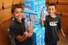 FRESH WATER: Elijah (left) and Lucas at Waimarama School with bottles of water supplied to the school from the Hastings District Council today. PHOTO/DUNCAN BROWN.