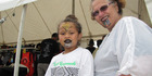 From Rotorua for Te Matatini, 5-year-old Mareikura Te Nahu and nan Anahera Bowen share a like interest in moko at one of the stalls in the festival expo. Photo / Doug Laing
