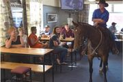 Wayne Smaill, of Outram, and his 5-year-old mare, Nah, at the Outram Hotel yesterday. Photo / Peter McIntosh