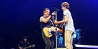 Bruce Springsteen gives props to a teen who held his own on stage. Photo / YouTube