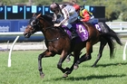 Excalibur draws clear to win at Ellerslie on Saturday to stake his claim for the NZ Derby. Photo / Trish Dunell