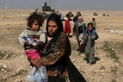 Dozens of Mosul civilians took the opportunity to flee yesterday. Photo / AP