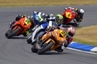Avalon Biddle (No21) leads the pack while contesting the NZ Supersport championship at Teretonga. Photo / John Thornton