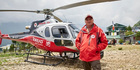 Kiwi Jason Laing with the Simrik Air B3 helicopter at Lukla helipad in Nepal.