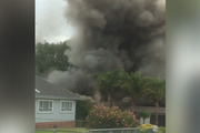 Fire is engulfing a home in Shirley Rd, Papatoetoe this morning. Photo / Supplied via Naitik Patel