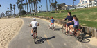 Liam Dann's family cycling along Huntington Beach, California.