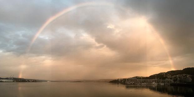 Loading The rainbow was set against a beautiful sunset in Wellington on Sunday. Photo / Carl Webley