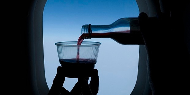 A little moderation can go a long way with inflight drinking. Photo / Getty Images