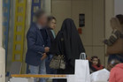 A man is filmed confronting Rahila in her niqab. Photo / SBS